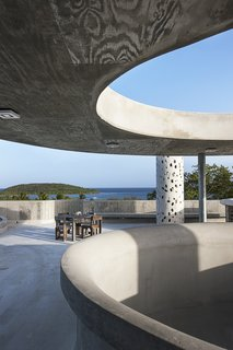 10 Works of Architecture That Reveal the Acrobatic Wonders of Concrete - Photo 3 of 10 - El Blok, a 22-room hotel in Vieques, Puerto Rico, strikes a unique profile. Its meandering shape features numerous cut-outs that let light in, casting playful shadows. The LEED Gold-certified property, designed by San Juan-based firm Fuster + Architects, shows the texture of the plywood boards that were used to create the building's framework.