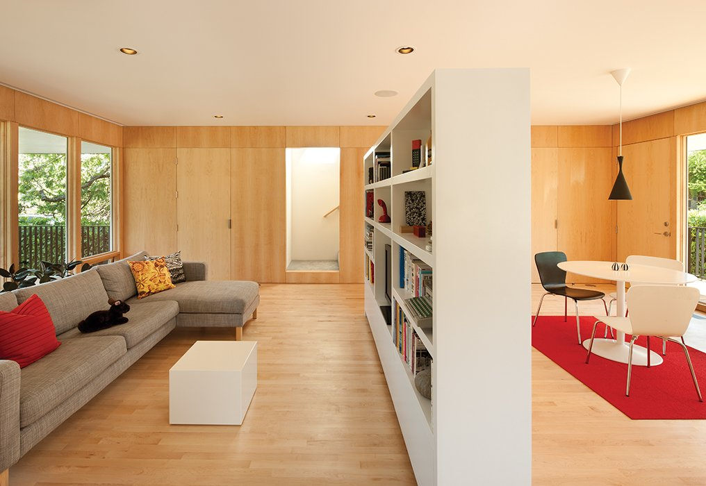 Waechter designed the custom bookshelf, which Oakley uses to define distinct spaces for living and dining.  Photo 4 of 9 in An Industrial Designer's House Blends Economy and Simplicity