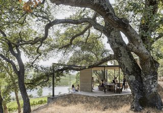 """These 7 Outdoor Pavilions Allow You to Connect With the Outdoors Comfortably - Photo 6 of 7 - """"The clean, modern lines and visual simplicity of the pavilions serve as a backdrop to the tasting experience and as a frame to the landscape beyond, while also sheltering visitors from the elements."""""""