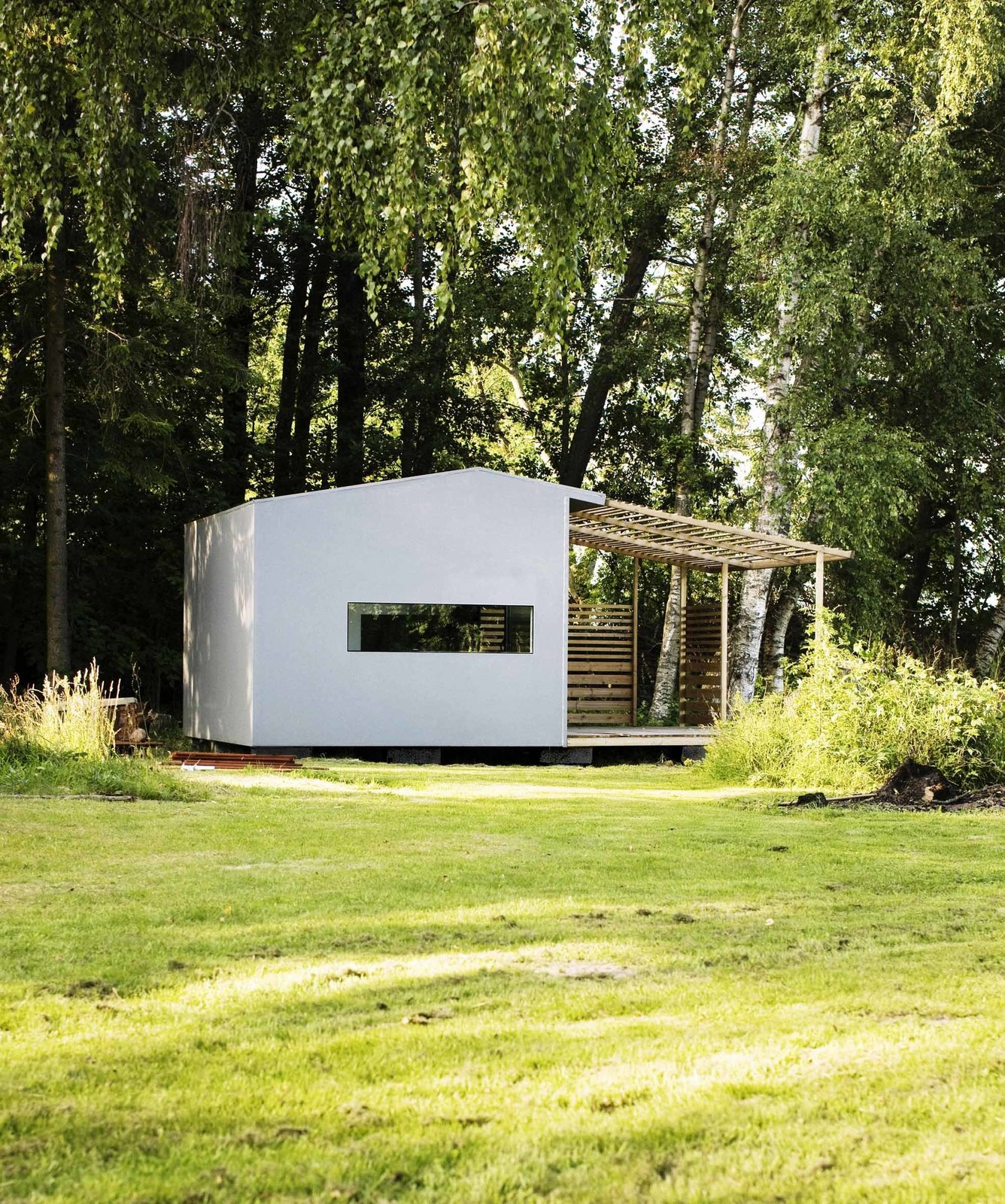 The homes are painted wood, and include a shaded deck space, plus full insulation and electricity, for a price of about $29,000. Tagged: Exterior, House, Wood Siding Material, Gable RoofLine, and Prefab Building Type.  Tiny Homes  by Erika Heet from Tiny Prefabricated House Can Be Built in Two Days