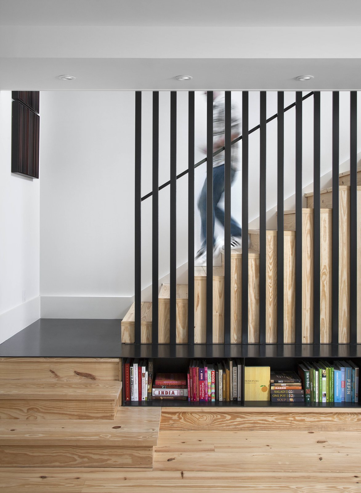 """The caged staircase was designed by architect Patrick Ousey, with whom Flournoy collaborated in the home's design. Although initially unconvinced by the staircase detail, """"it is a great example of how collaboration brings in different perspectives,"""" says Flournoy."""
