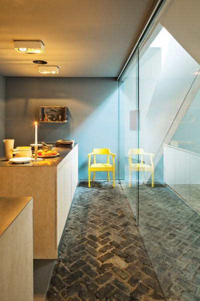 Wenes chose to keep the original brick floors to tie the older building to its past.