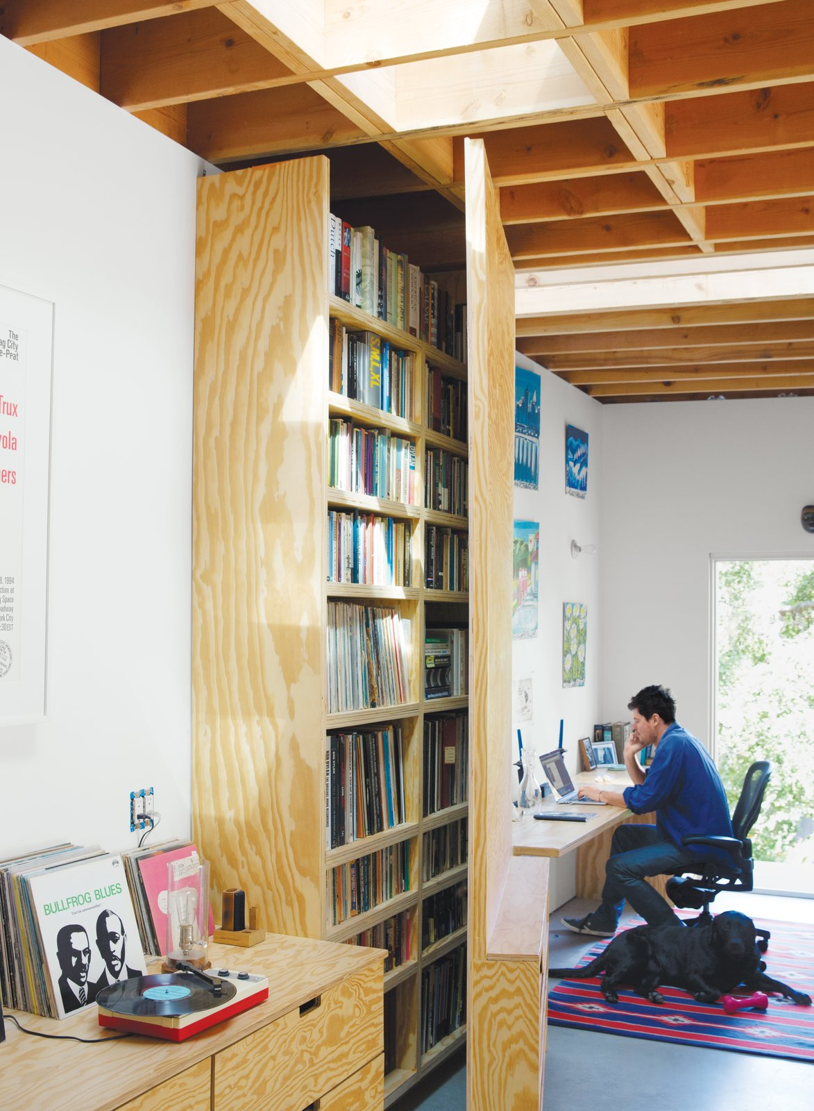 Designed by Jagoda, the door swings open to fit in front of a bookshelf.  Home Offices and Workspaces We Love by Matthew Keeshin from The Garage That's as Fun as the Living Room
