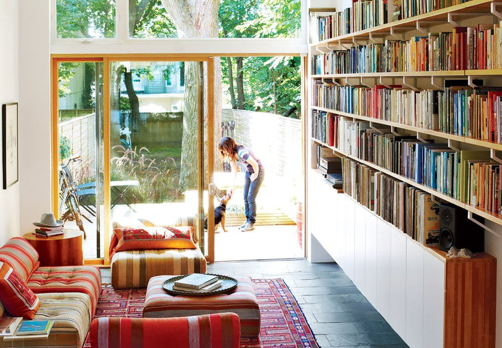 Architect Tamira Sawatzky used Ikea components—one-inch Lagan butcher block countertops and inexpensive Ekby Lerberg brackets—when designing the bookshelves along the living room wall in the home/studio he designed for himself and his wife in Toronto.  30+ Modern Homes With Libraries by Matthew Keeshin from Tips for Maximizing Bookshelf Space