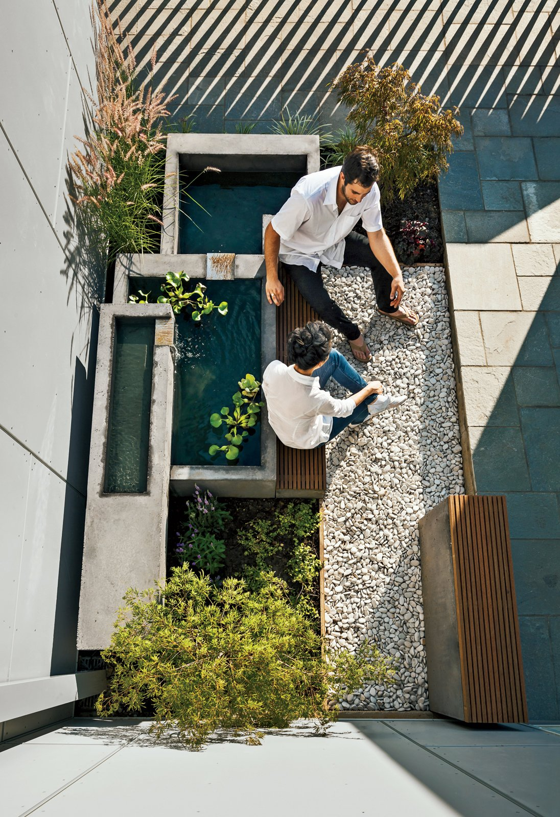 Höweler + Yoon squeezed high-design landscape elements, like a fountain and built-in seating, into a small 15-by-13-foot space. Tagged: Outdoor, Small Patio, Porch, Deck, Pavers Patio, Porch, Deck, Stone Patio, Porch, Deck, and Back Yard.  Photo 1 of 11 in Secret Garden