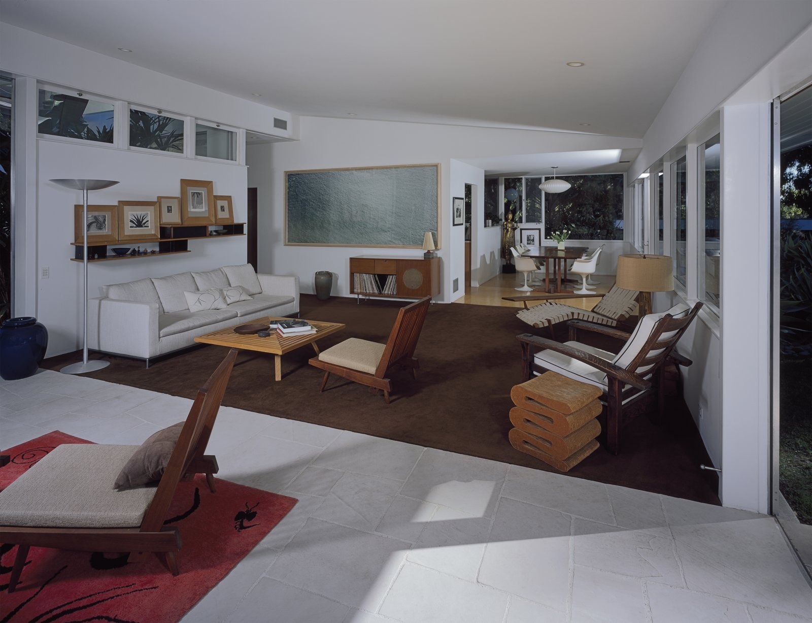 """The main space containing the living and dining area and kitchen was relatively unchanged. """"In consideration of the original vision, the additions blend with the original structure, and the basic idea of the open flow between the inside and the outside is maintained and reinforced in all areas,"""" the architect says.  Photo 5 of 6 in A Neutra Renovation in Los Angeles"""