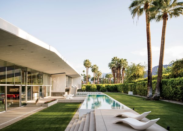 "A lap pool runs alongside the west facade of a hybrid prefab home in Palm Springs by Sander Architects. ""Our version of prefab,"" explains architect Whitney Sander, ""involves the use of building shells that are the 'heavy lifting' parts of any house: main structure, secondary  structure, and (often) building skin."""