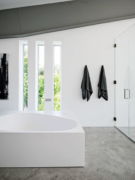 A Boffi tub is a defining feature in the master bath.  Photo 8 of 12 in An Energy-Efficient Hybrid Prefab Keeps Cool in the Palm Springs Desert