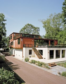 "12 Shipping Container Homes That Challenge the Meaning of Shelter - Photo 4 of 12 - Purchasing a lot off the Delaware River in Pennsylvania, Martha Moseley and Bill Mathesius adapted an unused concrete foundation—remnants of its previous owner's abandoned plans—to create a home that's uniquely their own. ""We were inspired by the site, and our desire to have something cool and different,"" says Moseley."