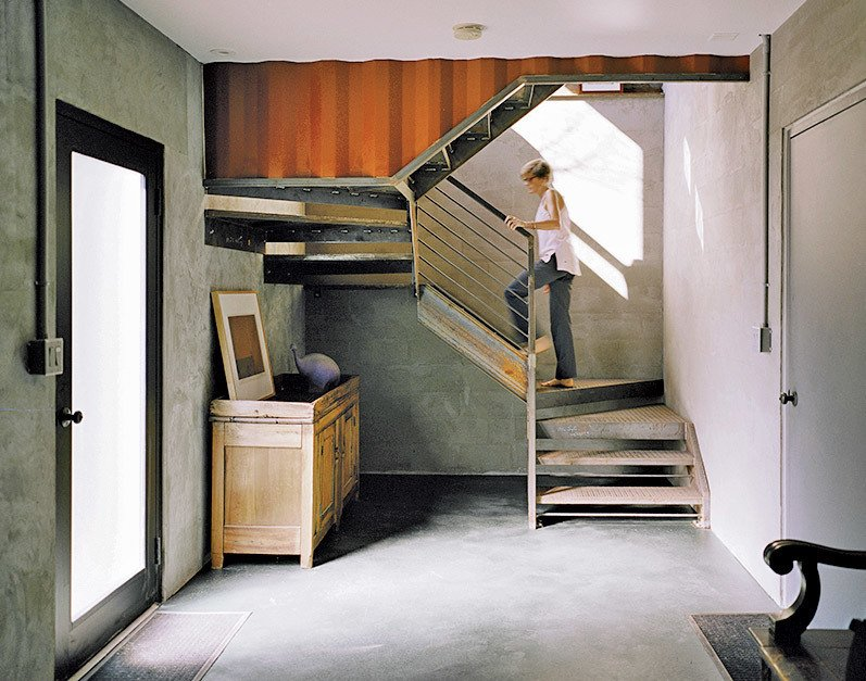 """The couple connected several of the shipping containers, hollowing out the sides to form large, open living areas. """"I've always been a loft guy,"""" says Mathesius."""