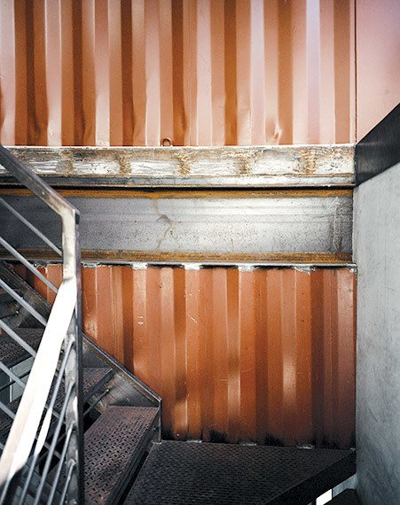 Embracing the industrial character of the corrugated steel material, he and Moseley applied the salvaged scraps as decorative siding for the hand-welded staircase.  Photo 4 of 12 in A Shipping Container Home in Pennsylvania Embraces Its Rugged Industrial Origins