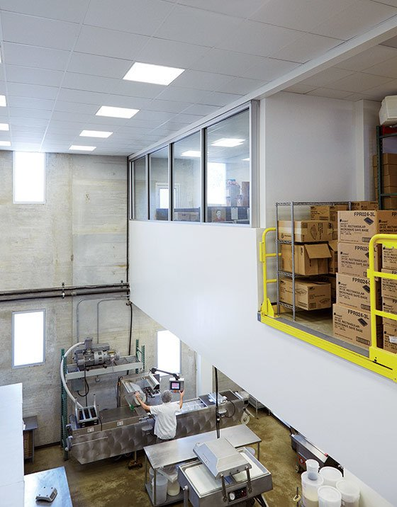 Windows fill the double-height manufacturing space with natural light.  Photo 3 of 9 in In Just 48 Hours, a Chicago Live/Work Space Is Built from the Ground Up Using Concrete Panels