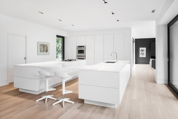 White was used extensively throughout the addition, a choice that the architects say enhances the spacious feel of the rooms and draws attention to the views. Photo 4 of Prince-Philip Residence modern home