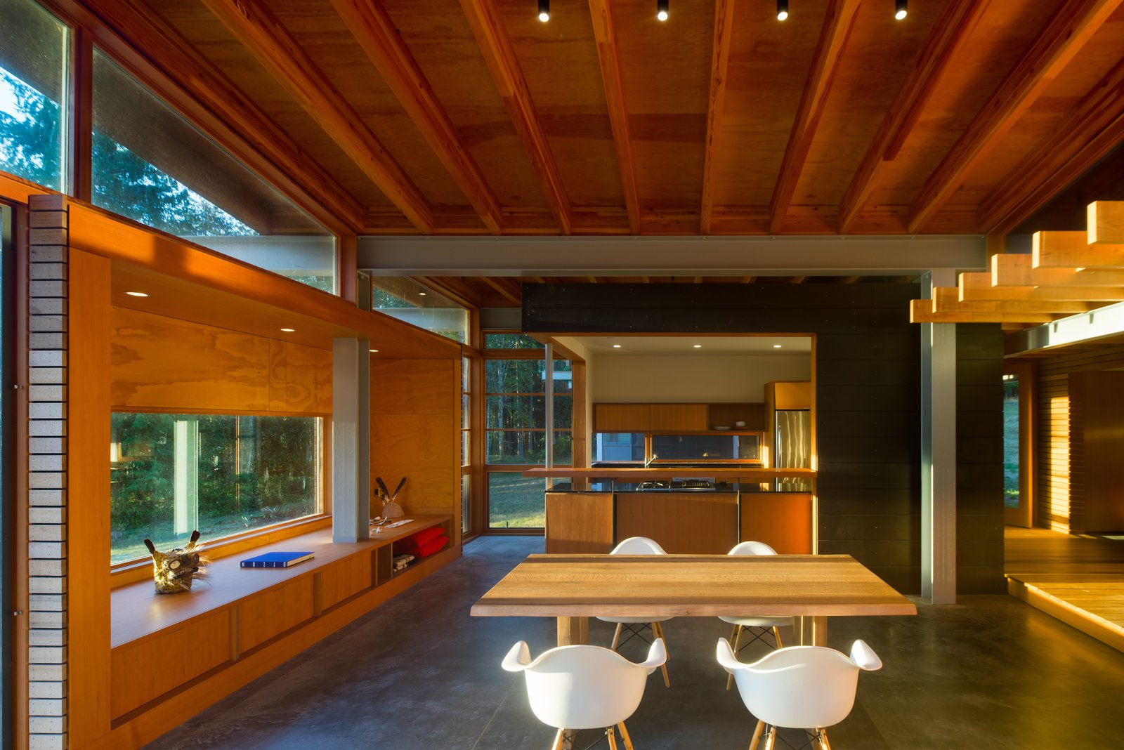The opposite view reveals a modest open kitchen.  Photo 10 of 16 in An Off-the-Grid Island Home for a Seattle Music Producer