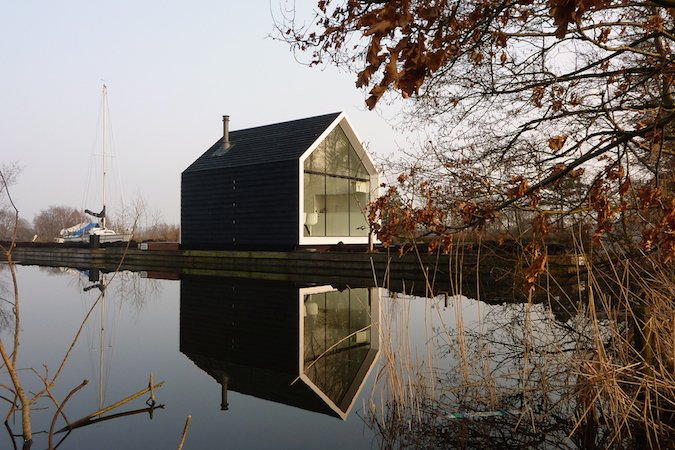 The Island House sits on a petite man-made island in 'Loosdrechtse Plas,' a lake area near Amsterdam and Breukelen (from which the New York borough gots its name). The thin strip of land, a result of peat farming centuries ago, inspired the design of the cabin.  Glass Prefab Cabin is Ultimate Outdoor Getaway by Patrick Sisson from House of the Week: Prefab Cabin with Glass Walls