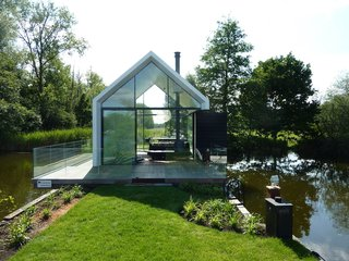 101 Best Modern Cabins - Photo 40 of 101 - According to Remijnse, since the only direction they could build on the small site was up, they decided to add height with a gabled roof.
