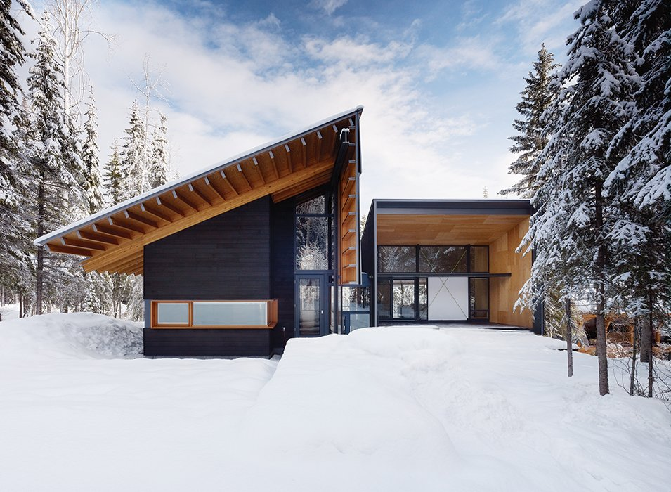 Douglas fir walls and beams extend to the exterior of a weekend house near Golden, British Columbia. Designed by Bohlin Cywinski Jackson and Bohlin Grauman Miller Architects, it was designed for an active family that likes to hit the slopes. A chalet-like pitched roof emphasizes its cabin feel.  Photo 1 of 3 in Modern Weekend Ski Home