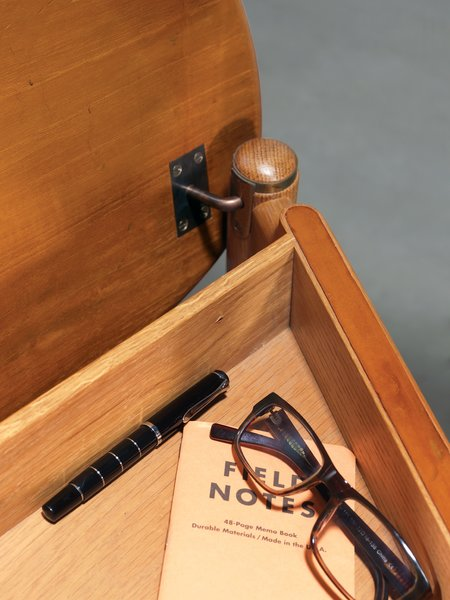 Wegner's design boats a storage compartment beneath the seat.