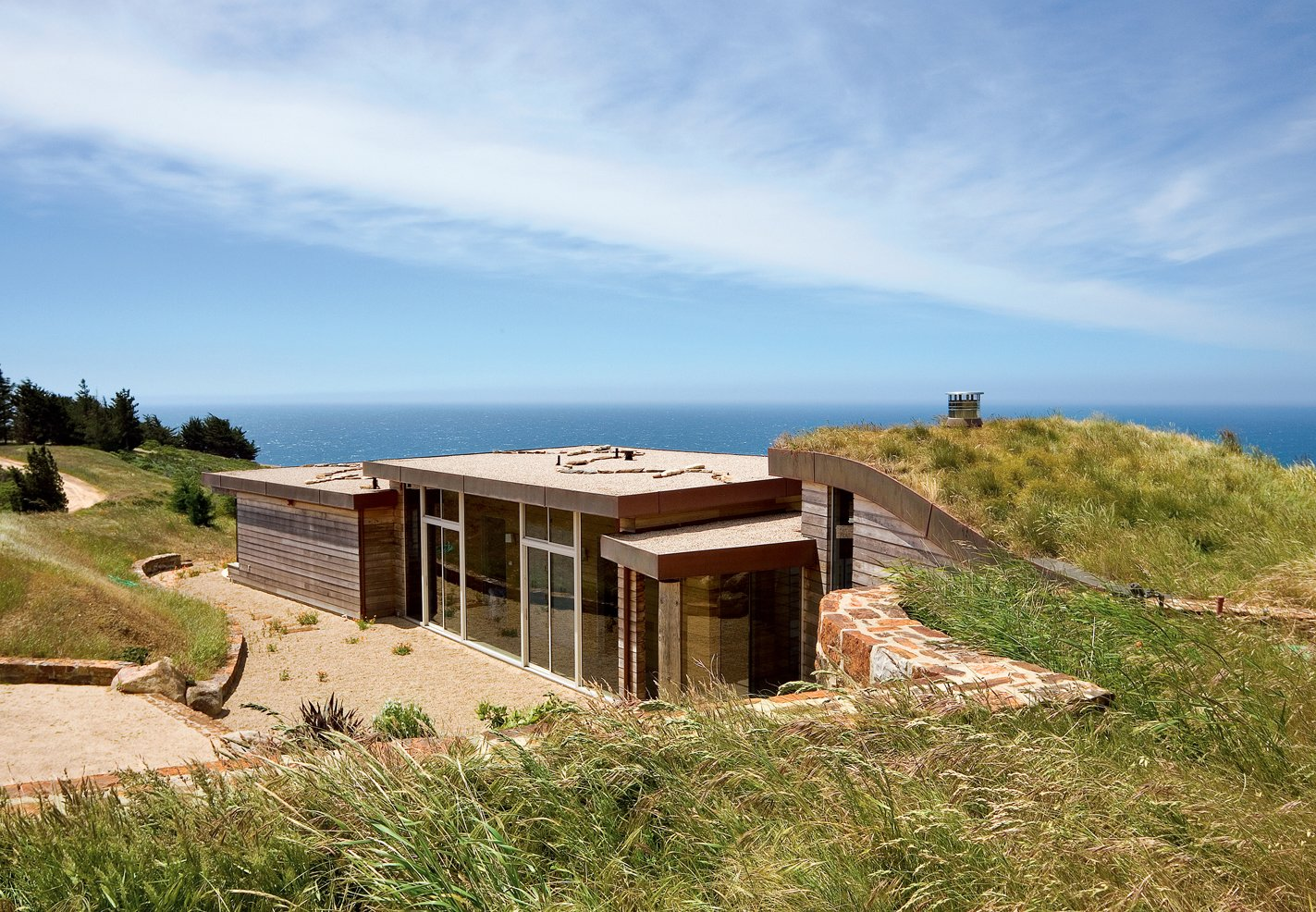 """I've been all around the world, and whenever I come back here, I realize that the Pacific Ocean seen from those cliffs is the most beautiful view on earth,"" says the resident of this house built into a hillside in Big Sur, California. 11 Hillside Homes That Feature a Balancing Act With Nature - Photo 2 of 10"