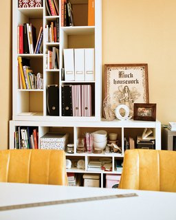 A bookshelf in Quite Strong's studio <br><br>holds a tongue-in-cheek motivational motto.