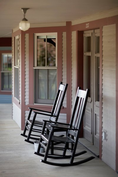Lined with antique rocking chairs, the space has a laid-back summer camp quality that seems to extend through the seasons.