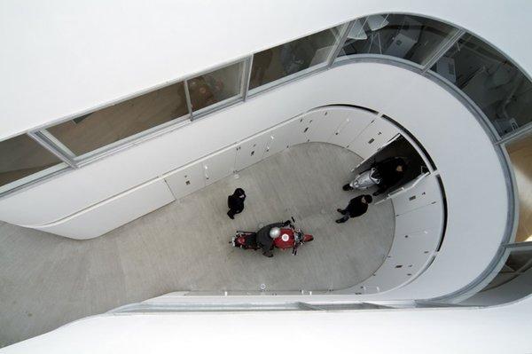 View more photos of this Tokyo apartment designed around motorcycles at wearedesignbureau.com. Photo by Hiroyasu Sakaguchi.