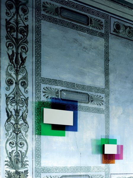 """Color on Color Mirror, for Glas Italia, 2010<br><br>In this three-part collection, Grawunder layers color """"like a painter would do,"""" including Rothko-esque """"black-out parts, which is what the mirror does."""" The mirror, at center, is the only part of the fixture that's not colored. """"They wouldn't let me put light in this,"""" Grawunder says, which, ultimately was a good idea. """"The color of the glass itself is so luminous, it almost looks backlit."""""""