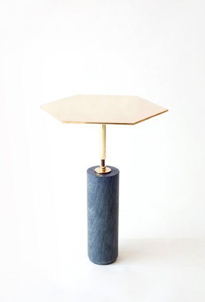 The Hawley side table ($1,850) has a hexagonal solid brass top and a base made from pietra cardosa marble. Use solo or group a fleet together to form a honeycomb-like coffee table.
