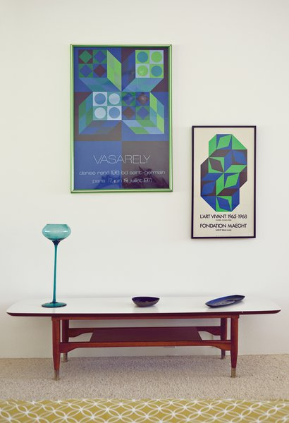 Paton has specialized in pottery and objets throughout her collecting career, though this pair of posters by Victor Vasarely carries this vignette in the bedroom.