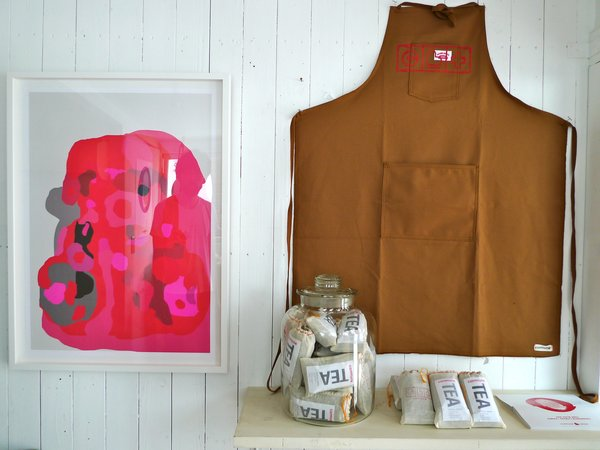 This apron and green tea are among the products sold by Commune to benefit tsunami victims. Photo courtesy Commune design.