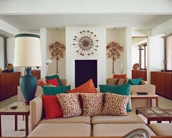 Architect Maurice McKenzie designed not just the home's symmetrical form but the seating in the living room too.