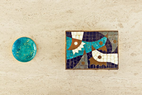 Elsewhere, secondhand finds and cool ceramics jazz up shelves and countertops.
