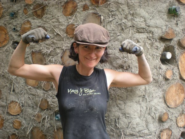 Mud Girl Clare shows off her muscles!
