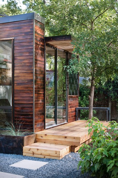 In addition to charred wood siding—shown here in the cherry stain—Sett Studio can also add decking and landscaping.