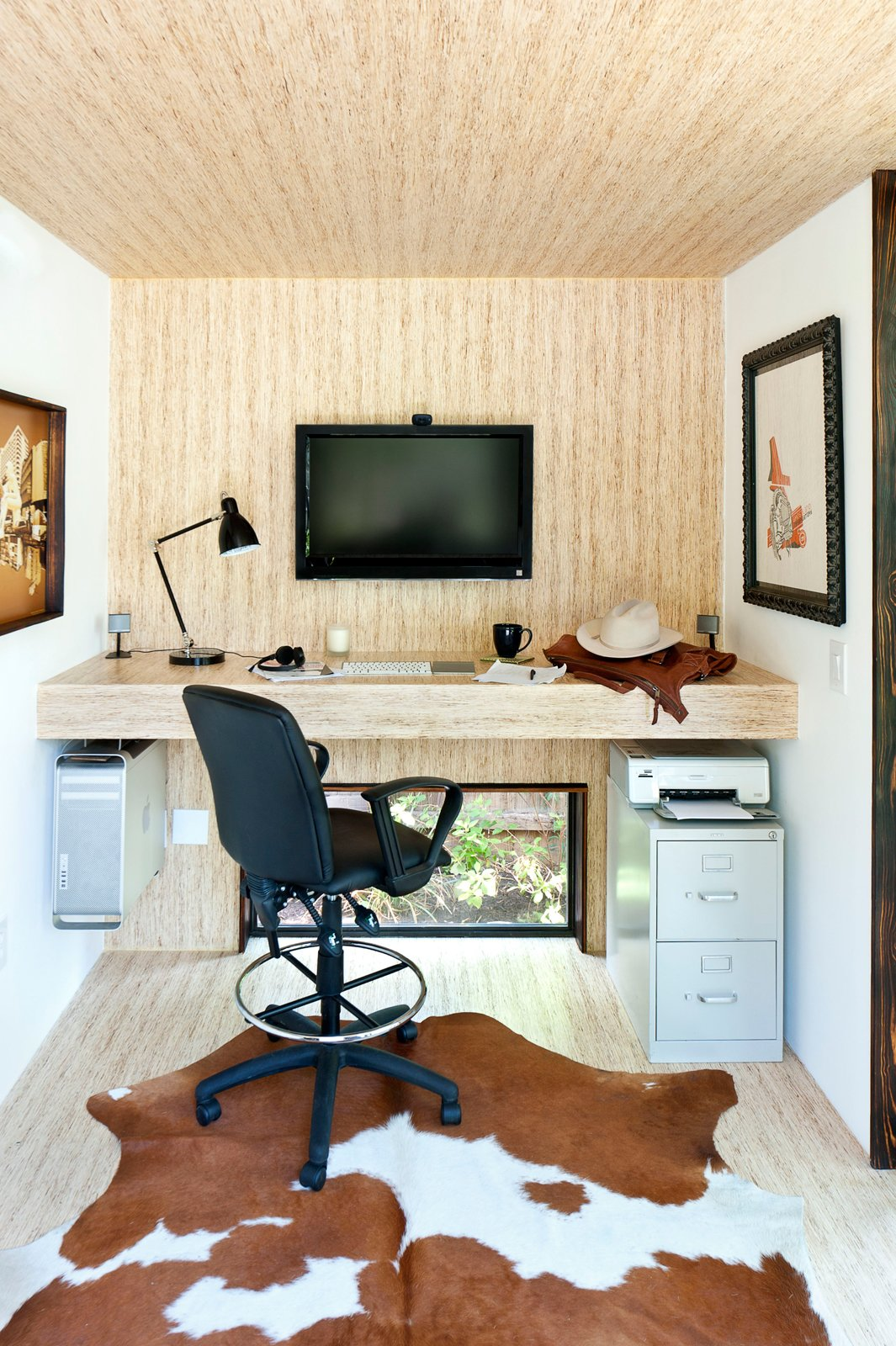 Sett Studio also does complete interior work. This unit features monotread, which are panels made from milled recycled wood, on the floor, walls and desk. Lately, the company has been using more bamboo. Tagged: Shed & Studio and Storage Space.  Photo 6 of 13 in On Your Mark, Get Sett