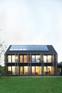 Passive Progressive - Photo 2 of 8 - Sun Volt<br><br>With the roof angled at 43 degrees, the architects lined the southern slant of the house with solar panels to collect as many rays as possible. Karanesheva and Witzmann started with four, but then added 23 more, all by Systaïc; the company gave them a deal since theirs was its first installation in France. The panels now collect far more energy than the home actually needs, a precious resource that the pair sells back to the power company.<br><br>systaic.com
