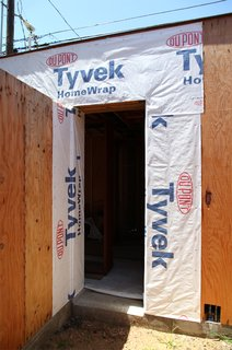 Dwell Home Venice: Part 14 - Photo 1 of 9 - Dupont Tyvek weather barrier covers the wall near a doorway. Tyvek flashing will be added prior to the door installation.