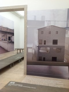 Projects in the German pavilion show large-scale photos of models and buildings depicting how the country's architects are reworking the existing fabric of the city. The exhibition reuses the temporary sidewalks that are used when Venice floods.
