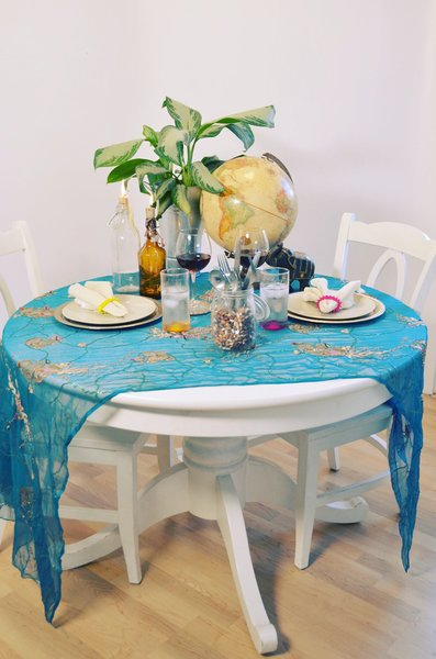 Scarves instead of tablecloths can be an easy and colorful alternative.