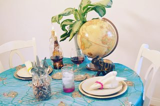 Unexpected items, like this globe, can come from different parts of the home to liven up a table setting.