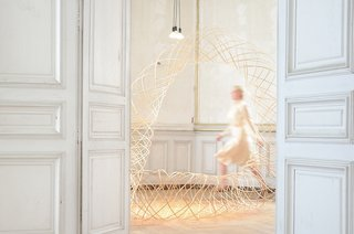 'Moving Meshes' at Domaine de Boisbuchet - Photo 1 of 8 - The sunlit interiors of Domaine de Boisbuchet come to life with Dutch designer Maria Blaisse's bamboo structures in the Moving Meshes exhibition. Part organic sculpture, part costume design, these lattice-like forms suggest new possibilities for textile applications in architecture and design.