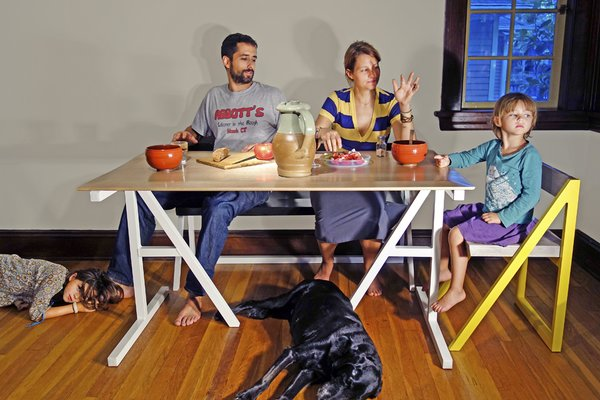 Mark Moskovitz and his family dine at the table he designed.
