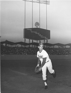 Sandy Koufax, perhaps the team's greatest pitcher, warms up in front of the park's classic butterfly awnings in 1964. All photos courtesy L.A. Dodgers.