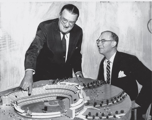 Dodgers owner Walter O'Malley shows a model of his stadium to Yankees owner Del Webb.