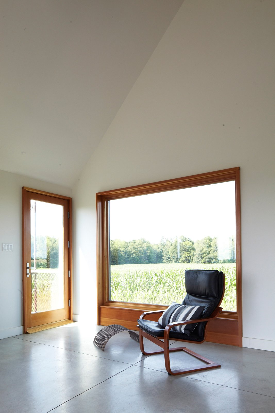 Though the house is only 925 square feet, Moffitt argues that it feels much larger, for which she credits three factors: its visual connections to the outdoors, its open spaces, and its simple interior-design language.  Photo 12 of 16 in A Sustainably Built Home in Rural Ontario