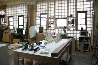 Stephanie Beamer does most of the woodworking in their shop just  a few floors up from the studio.