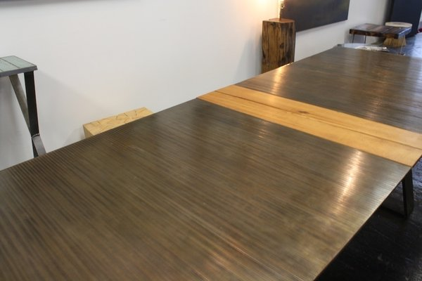 Velloso works primarily in steel and wood. A table like this is made of 246 steel bars welded together and takes him about three weeks to complete.