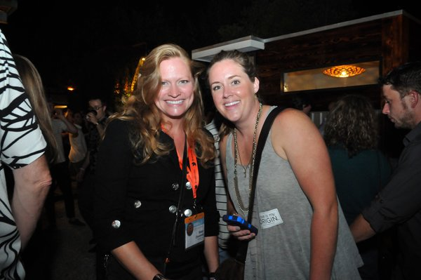 Two happy SXSW Eco attendees smile for the camera.