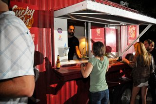 Dwell Party Highlights: Celebrating Prefab Design at SXSW Eco - Photo 12 of 20 - Pop up attendees line up for free vegan eats including an arugula and fried-green-tomato salad from Lucky J's restaurant, a local food truck favorite owned by Jason Umlas. (Special thanks from Dwell to Wade Beesley for coordinating!)