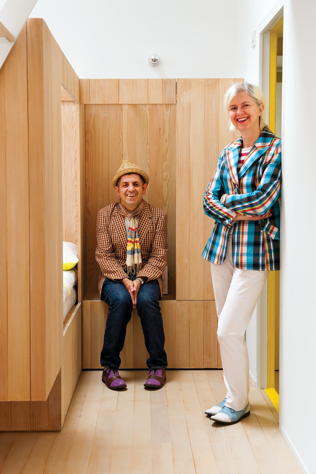 Industrial designer Nina Tolstrup and her husband, Jack Mama, designed this playful guesthouse just opposite their home in London's Bethnal Green. Tagged: Bedroom, Bunks, Light Hardwood Floor, and Wall Lighting.  Photo 1 of 10 in A Colorful, Custom-Built Guesthouse in London